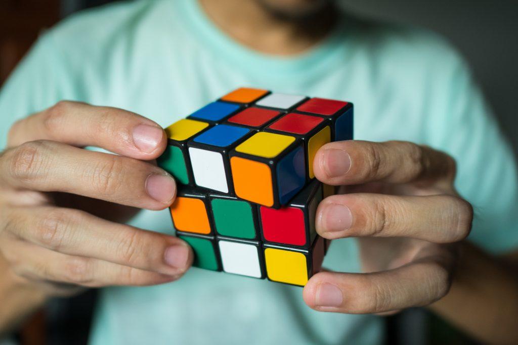 man solving rubix cube
